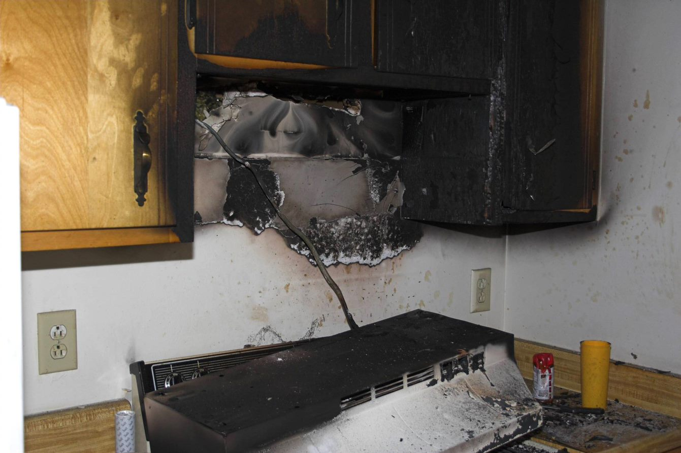 kitchen covered in soot along cabinets